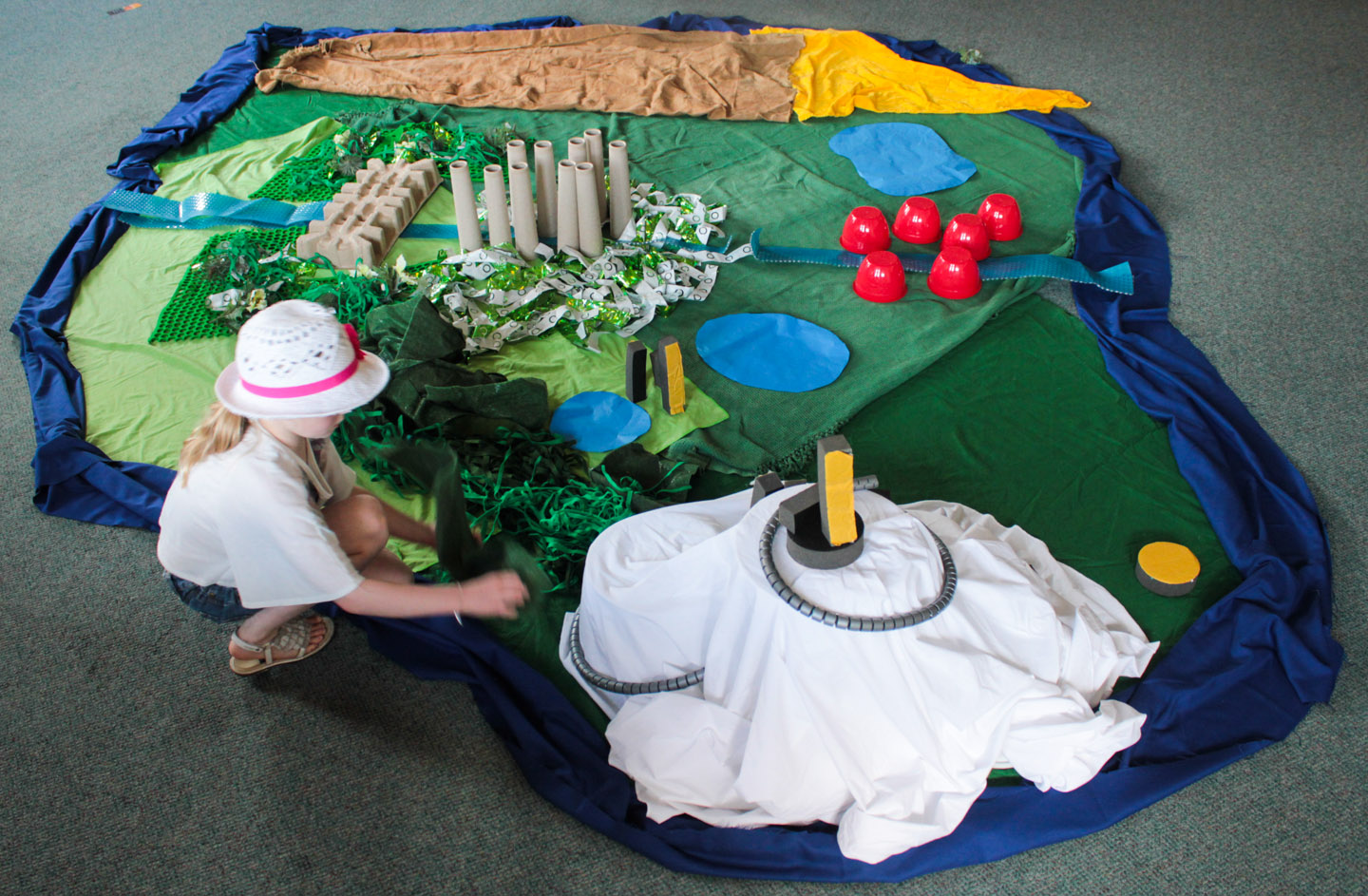 Creating scrap-map story islands in Daniel Ingram-Brown's children's workshop. Photographs by Rebecca Witt