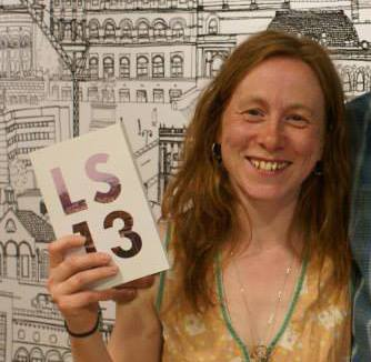 Leeds writer Aissa Gallie with her copy of the LS13 anthology